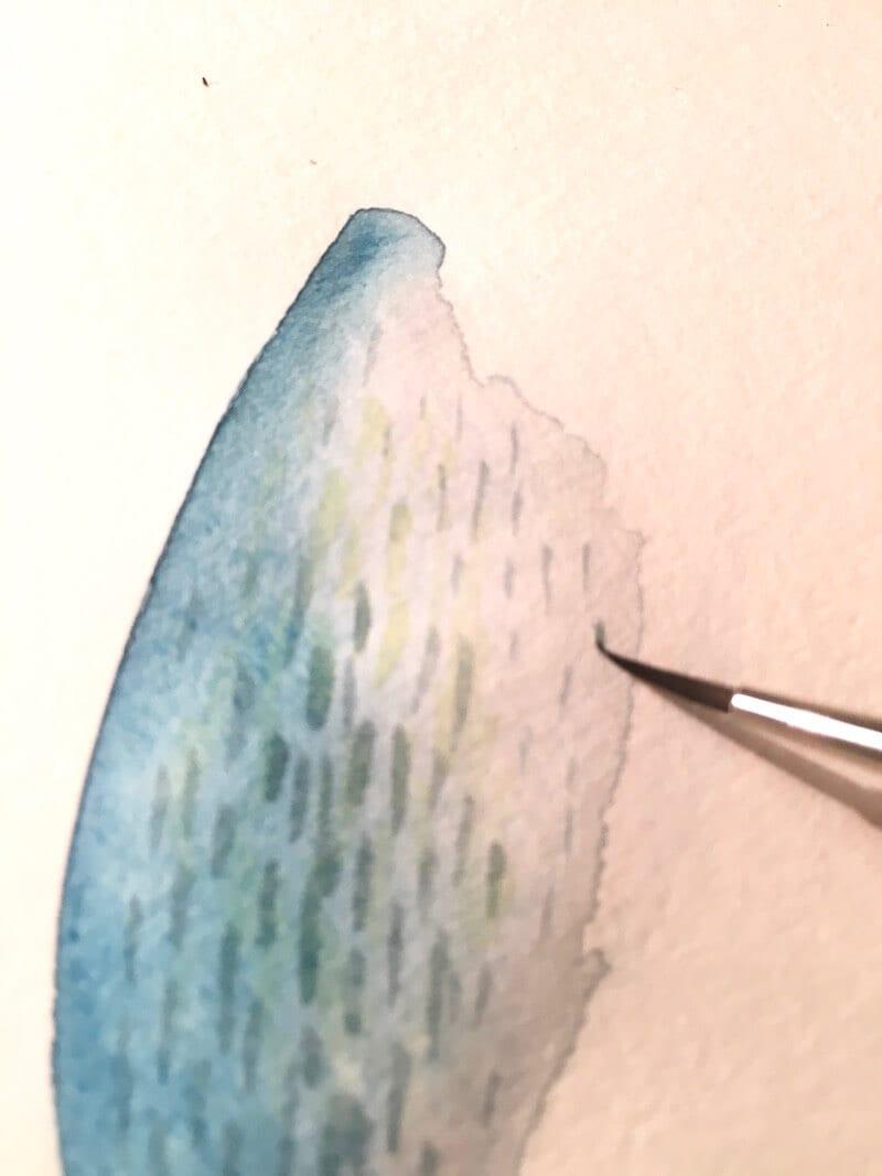 du siehst eine strichlierung in olive auf ultramarinblau