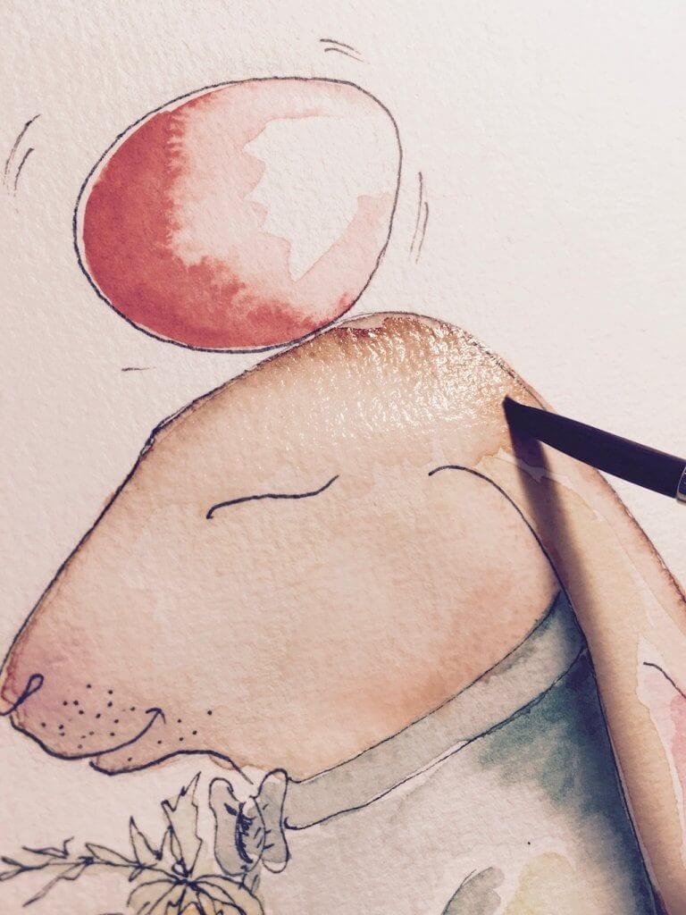 Du siehst wie Dodo den Hasenkopf ausmalt