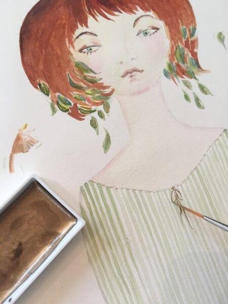 Man sieht eine Aquarellfarbe in Gold in einem kleinen Tiegel. Dazu ein junges Mädchen im Artdeco-Stil in pastellen Grüntönen. Das Bild wurde von der Künstlerin Dodo Kresse gemalt.