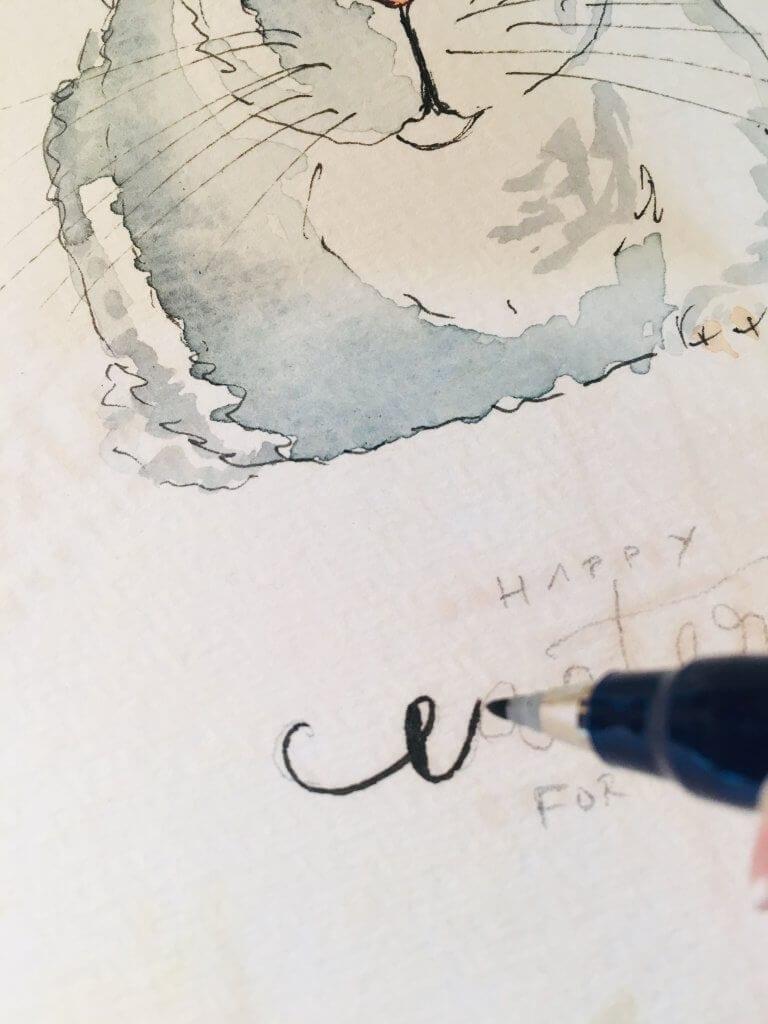 Du siehst hier wie Dodo mit einem kalligraphischen Stift den Ostergruß wettert