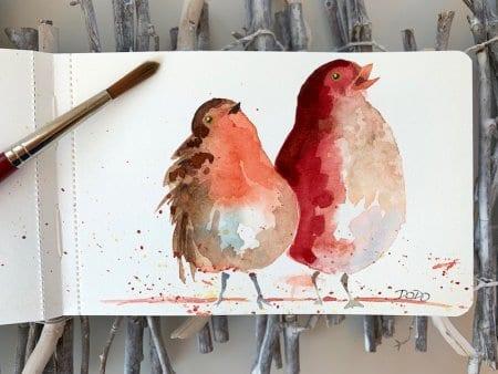 Man sieht das fertige Aquarell, es sind zwei rote Vögel zu sehen, gemalt von Dodo Kresse