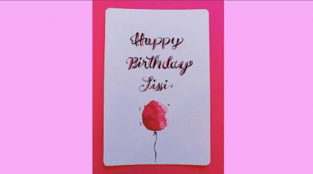Man sieht eine Geburtstagskarte mit Lettering Technik von Dodo Kresse