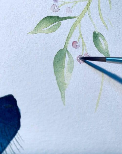 Lass deiner Phantasie freien Lauf. Die Beeren können alle Farben haben, von sanftem Rosa bis grellem Orange. Achte darauf, dass sie gut zum Katzenmotiv passen.