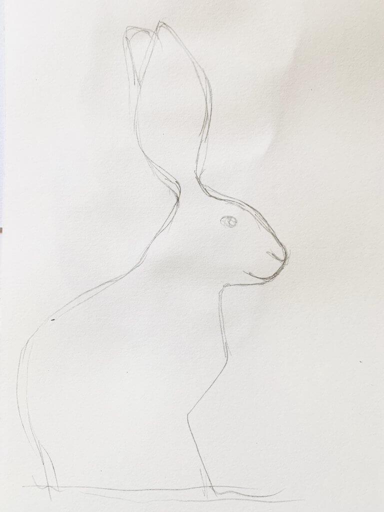 Hier siehst du eine Vorzeichnung des Osterhasens im Profil mit Bleisitft