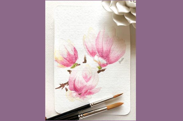 Man sieht ein Aquarell von Magnolienblüten der Künstlerin Dodo Kresse für Creative Club