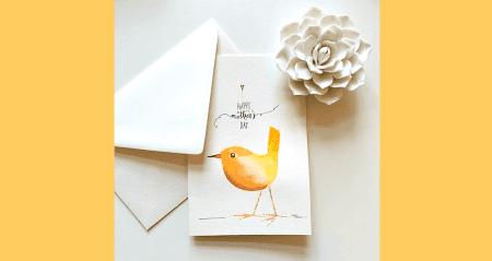 Du siehst die fertige Muttertagskarte mit Aquarellfarben gemalt und mit Tusche gelettert
