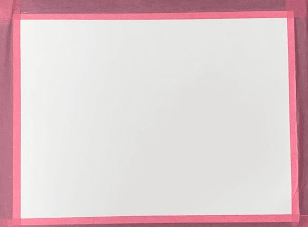Du siehst das leere Aquarell Papier mit Tesa aufgespannt