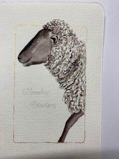 Du siehst unter dem Kopf vom Weihnachts-Schaf den vorgezeichneten Schriftzug Määähry Christmas