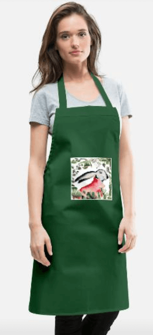 Du siehst eine grüne Küchen- oder Gartenschürze mit meiner Osterhasen-Illustration