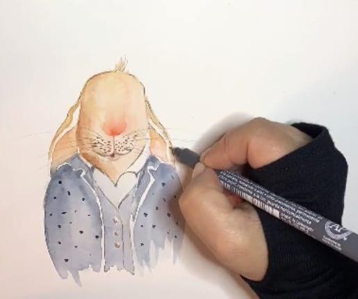 Im fünften Schritt der Osterhasen Zeichnung werden die Outline mit Tuschestift gezeichnet