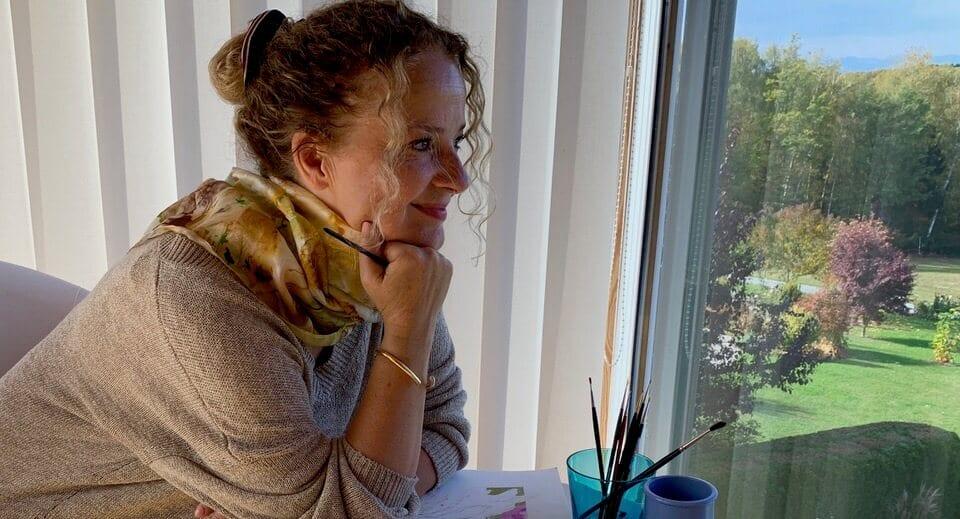 du siehst ein Bild, auf dem ich aus dem Fenster meines Ateliers schaue