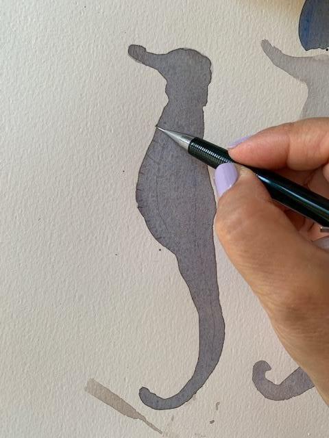 Du siehst die erste Lasur der Aquarell-Skizze Seepferdchen mit Aquarellfarben