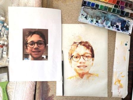 Auf meinem Tisch das fertige Kinderportrait und mein Malkasten