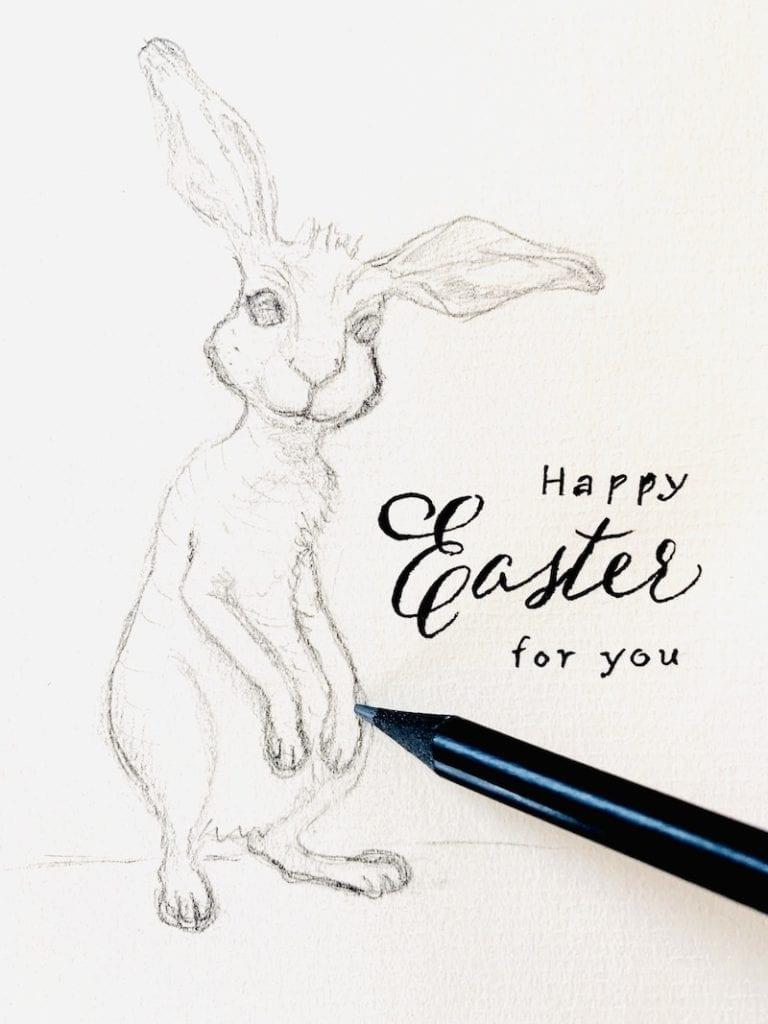 du siehst einen gezeichneten Osterhasen mit Glückwunsch zu Ostern